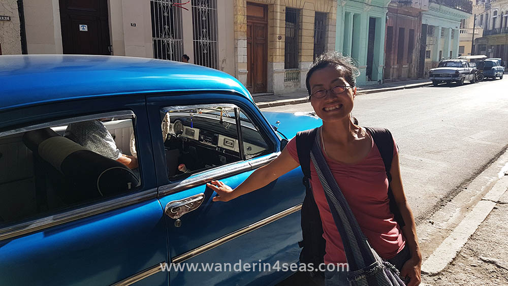 Me with a vintage car taxi in Havana