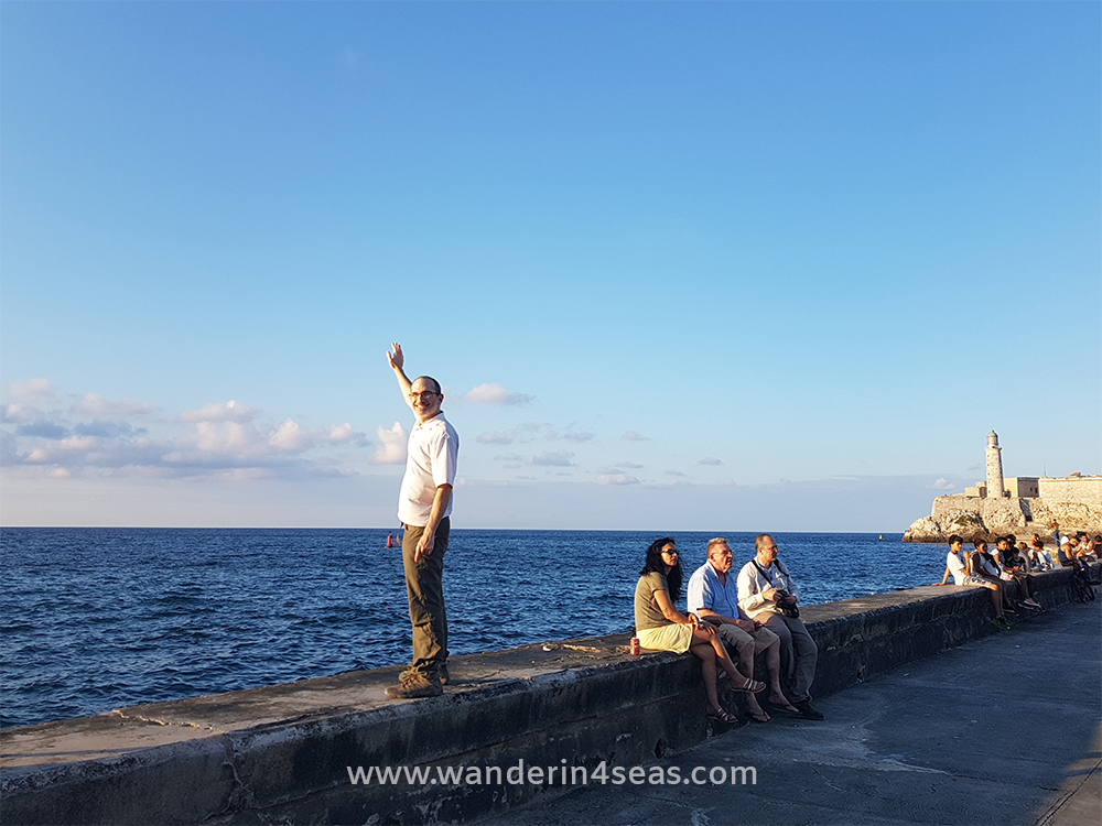 Todd standing on the sea wall of Malecón