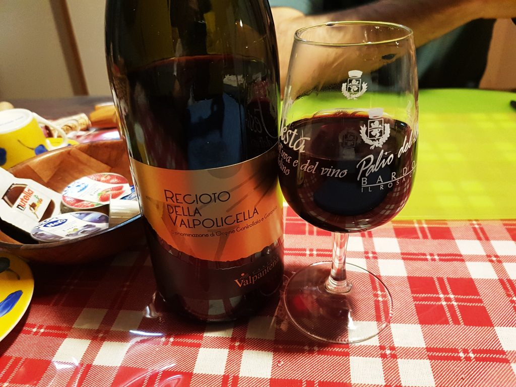 Enjoying local wine in the evening at our Belluno airbnb flat
