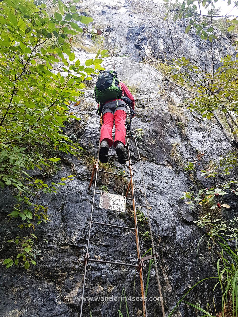 Climbing a ladder at VF Centenario